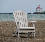 Seashell colored polywood Adirondack chair